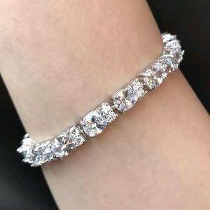 Jewelry - 18kwgp oval cut topaz tennis bracelet.